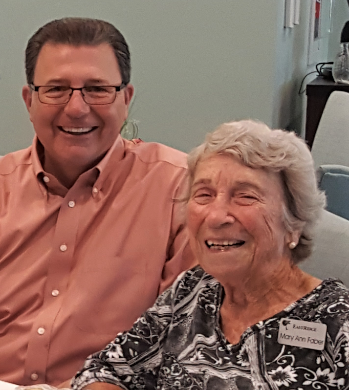 East Ridge Legacy Society Member Mary Ann Faber enjoys a smile with Executive Director Ken Cormier